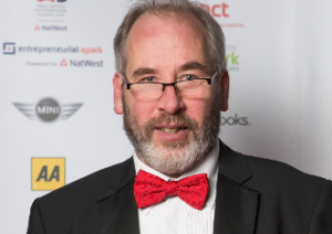 Image of Jonathan Lodge wearing suit and red bow tie