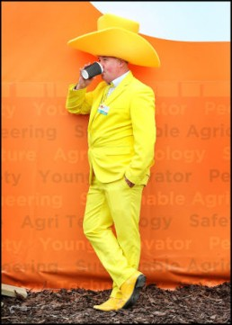 Man in yellow suit and hat