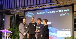 Kisan Hub accepting award for AgriTech company of the year with Emma Fletcher